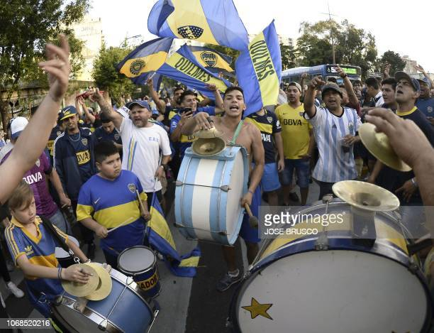 In this photo released by Noticias Argentinas supporters of Boca Juniors gather at Lezama park in Buenos Aires on December 4 2018 to cheer for their...