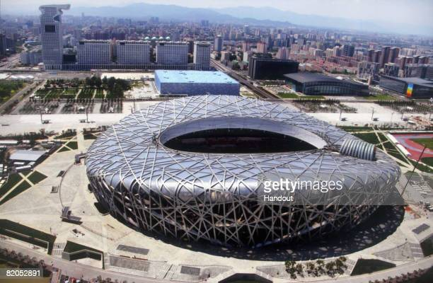 In this photo released by the Beijing Tourism Administration China's National Stadium known as the Bird's Nest and the National Aquatics Center known...