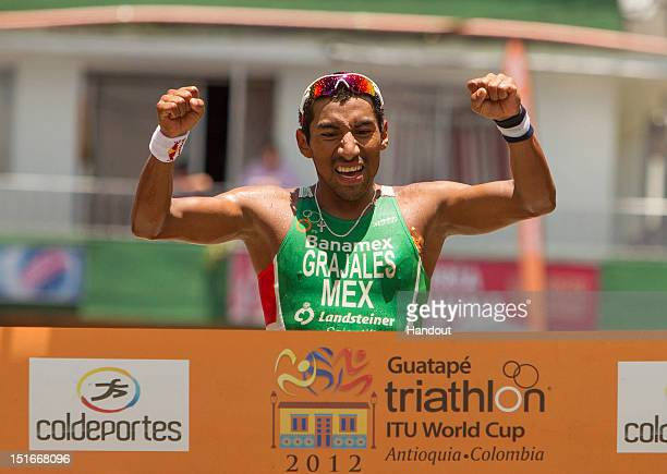 In this photo released by the International Triathlon Union, Crisanto Grajales of Mexico celebrates his first ITU Triathlon World Cup victory at the...