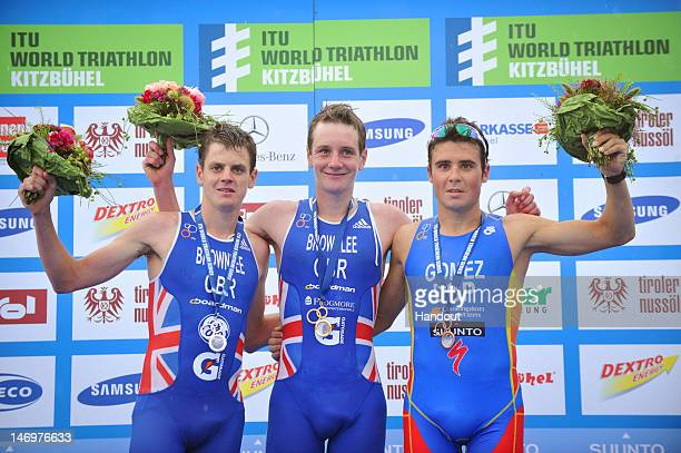In this photo released by the International Triathlon Union Great Britain's Alistair Brownlee with gold brother Jonathan Brownlee with silver and...
