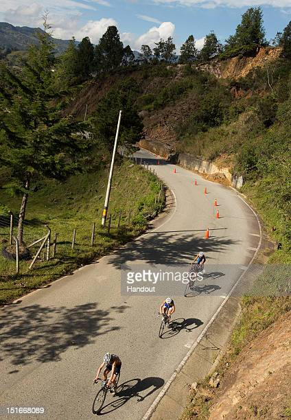 In this photo released by the International Triathlon Union, the elite women tackle the challenging but scenic bike course at the 2012 Guatape ITU...