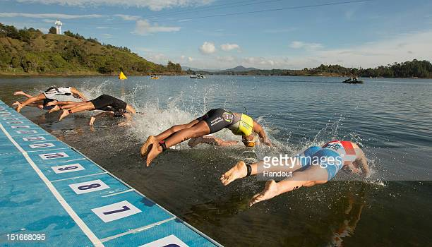 In this photo released by the International Triathlon Union, the elite women's field dives into Guatape lake to begin the 2012 Guatape ITU Triathlon...