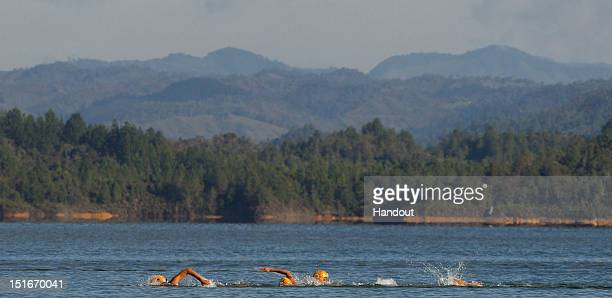 In this photo released by the International Triathlon Union, the elite women swim amidst the scenic backdrop of Guatape at the 2012 Guatape ITU...