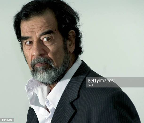 In this photo released by the Iraqi Special Tribunal Saddam Hussein is questioned by Chief Investigative Judge Raid Juhi August 23 2005 in Iraq...