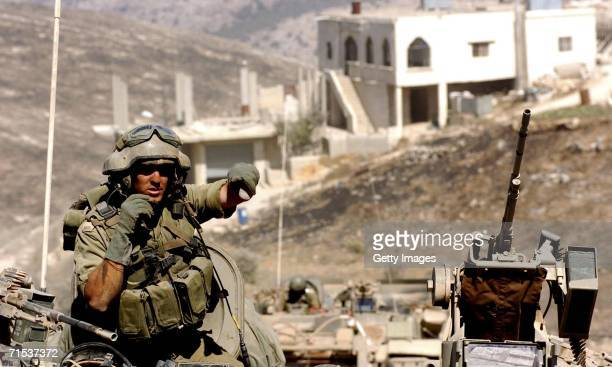 In this photo released by the Israel Defense Forces , Israeli troops operate against Hezbollah militants July 29, 2006 in the south Lebanese village...