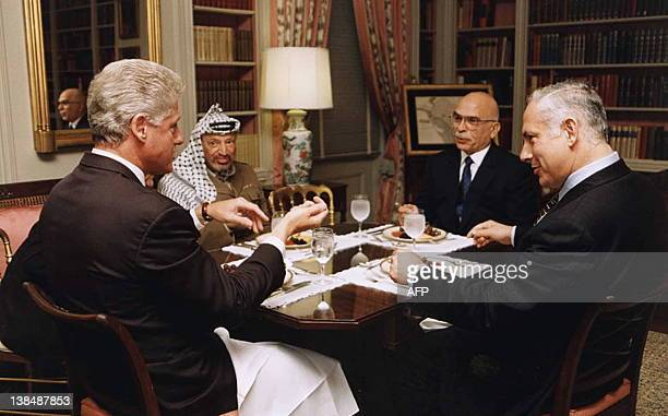 In this photo released by the White House 01 October, US President Bill Clinton meets with Palestinian President Yasser Arafat, Jordan's King Hussein...