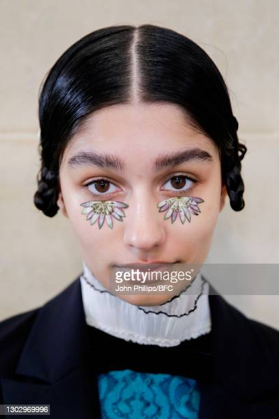 In this photo released on February 19 A model is seen backstage at the BORA AKSU show during London Fashion Week February 2021 at Tate Britain on...