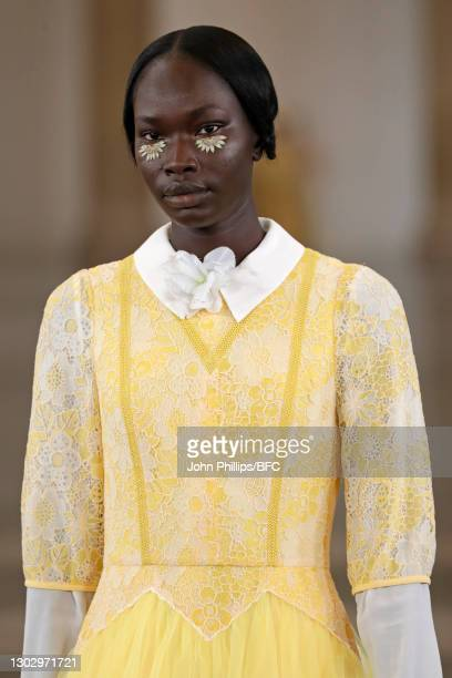 In this photo released on February 19 A model walks the runway during the BORA AKSU show during London Fashion Week February 2021 at Tate Britain on...