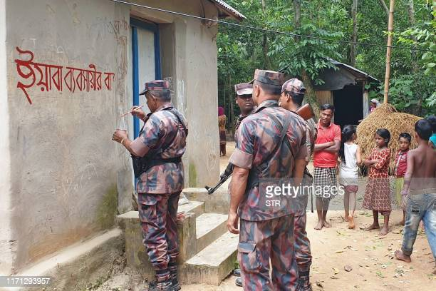 In this photo take on September 23 2019 shows Bangladesh border guards marking with red paint the phrase House of yaba trafficker referring to cheap...