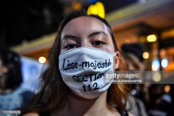 In this photo taken August 3 a protester wears a mask relating to Thailand's lese majeste laws during a Harry Potterthemed antigovernment rally at...