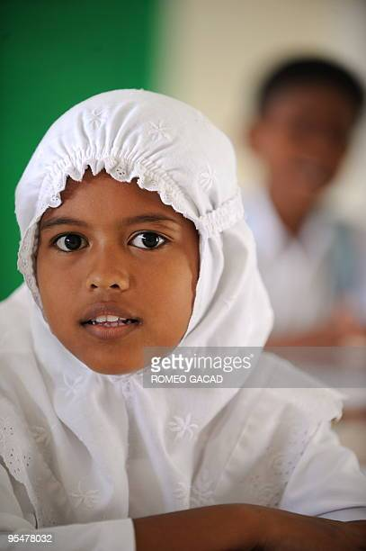 In this photo taken December 3 2009 Indonesian tsunami survivor Ikra Alfila attends her class at a school in Lampuuk village in Banda Aceh Five years...