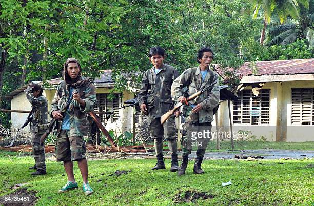 In this photo taken February 9 2009 shows armed government militia belonging to the Civilian Volunteers Organization take position near a school...