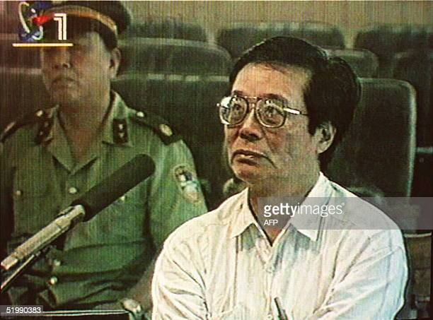 In this photo taken from a Chinese State television evening broadcast 24 August US human rights activist Harry Wu is seen listening at his trial in...