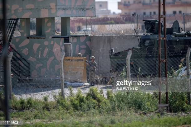 In this photo taken from the Turkish side of the border between Turkey and Syria in Akcakale Sanliurfa province southeastern Turkey shows a soldier...