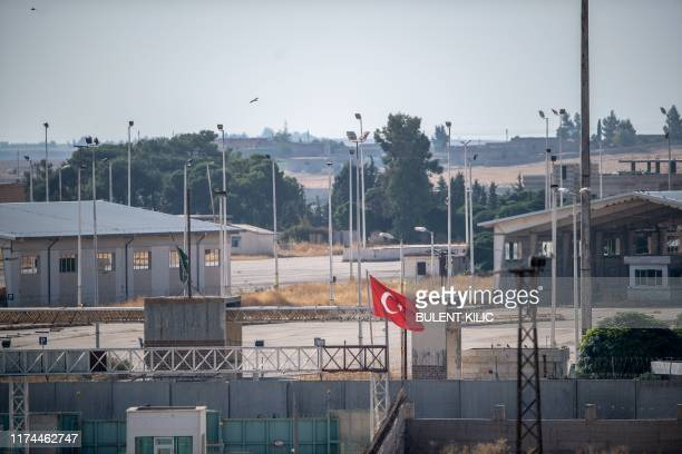 In this photo taken from the Turkish side of the border between Turkey and Syria in Akcakale Sanliurfa province southeastern Turkey shows a gate...