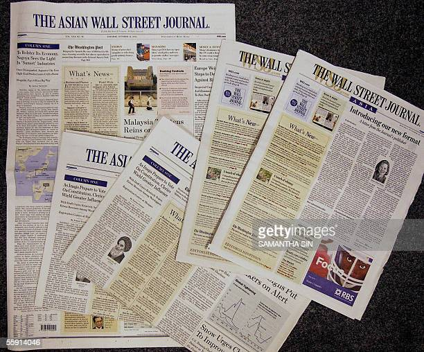 In this photo taken in Hong Kong 13 October 2005 shows the old and new copies of the Asian Wall Street Journal The Asian edition of the Wall Street...