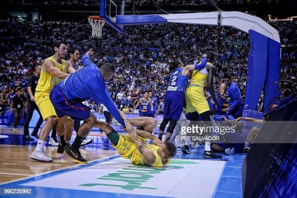 TOPSHOT In this photo taken July 2 a general shot of the brawl between Philippine and Australian players during their FIBA World Cup Asian qualifier...