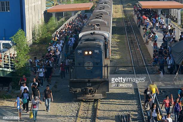 In this photo taken May 7 2014 shows passengers alighting a tain at a station of the Philippine railroad in Manila where trolley operators use the...