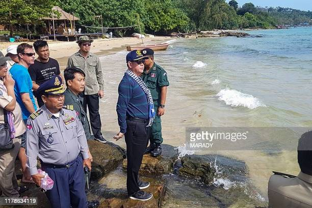 In this photo taken October 27 Sihanoukville Governor Kuoch Chamroeun and officials look over the shore of Koh Rong island during a search and rescue...