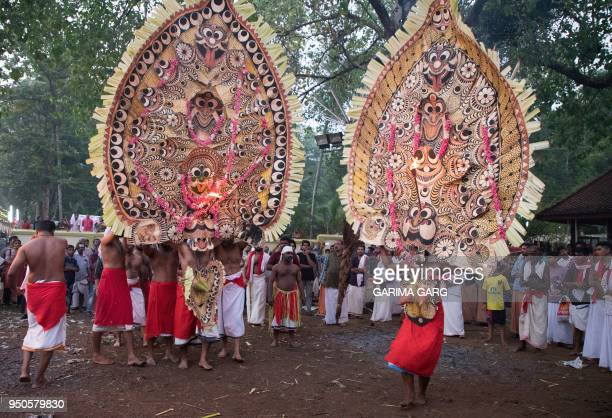 In this photo taken on April 21 Indian performers take part in the Bhairavi Kolam dance wearing large masks built by artisans for the event to...