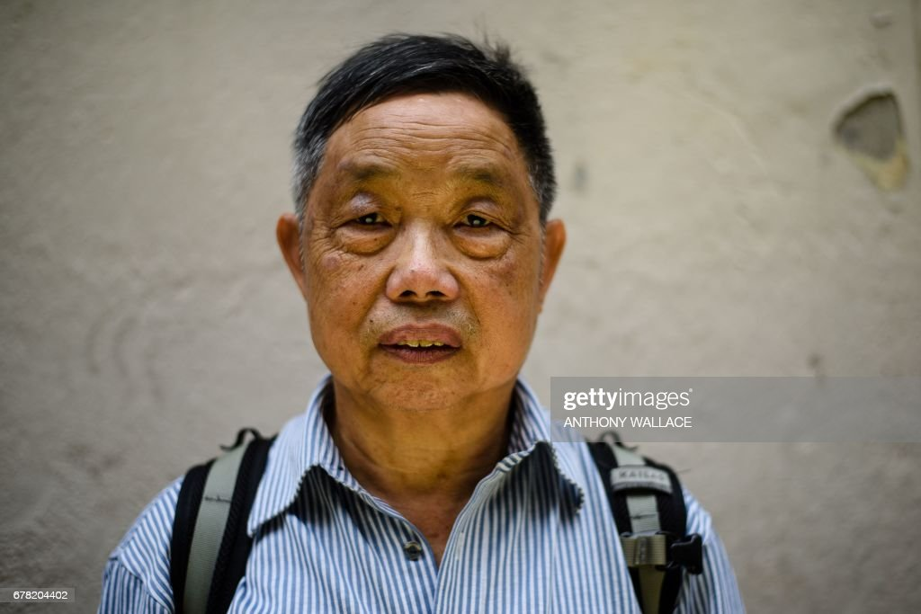 In this photo taken on April 27, 2017, Luk Tak-shing, 70, who was jailed during the May 1967 riots, poses for AFP in the Sai Wan Ho district of Hong Kong. Hong Kong is unrecognisable now from the city which 50 years ago was the scene of bloody riots, fuelled by resentment of colonial rule and inspired by the Cultural Revolution unfolding in China. But although memories of the bomb-strewn chaos of 1967 have faded, the city is facing a new era of turbulence as democracy activists take on Beijing and many ordinary residents still struggle to make ends meet. / AFP PHOTO / Anthony WALLACE / TO GO WITH Hong Kong-China-Britain-politics-riots-anniversary, FOCUS by Elaine YU
