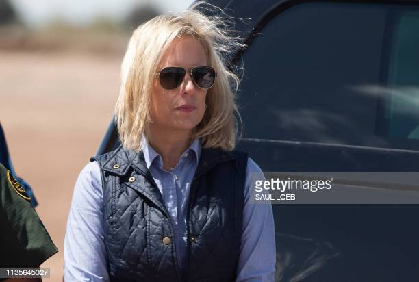 In this photo taken on April 5 Secretary of Homeland Security Kirstjen Nielsen waits for US President Donald Trump as he arrives to tour the border...