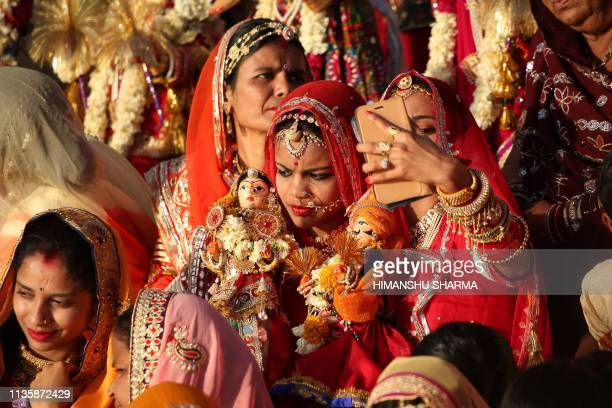 TOPSHOT In this photo taken on April 8 Indian married women take a selfie on a smartphone as they take part in the Gangaur festival in Udaipur in...