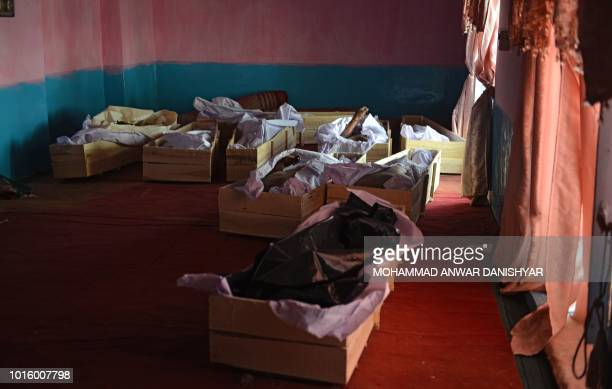 TOPSHOT In this photo taken on August 12 2018 coffins with corpses are seen on the floor of a mosque inside a hospital following clashes with Taliban...