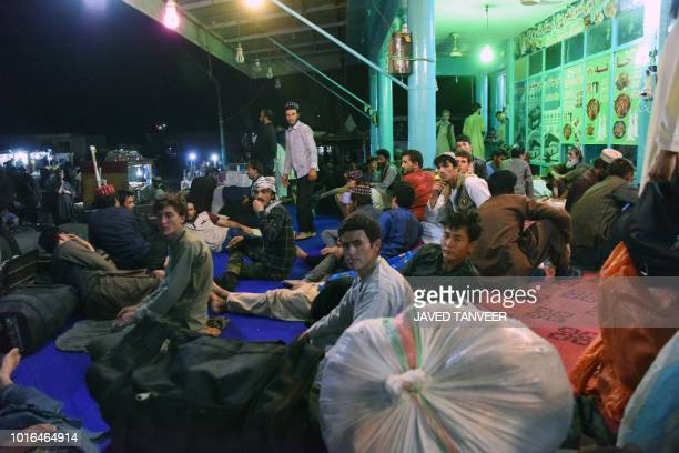 In this photo taken on August 13 2018 Afghan passengers bound to Kabul wait at a bus station in Kandahar province as the KabulKandahar bus services...