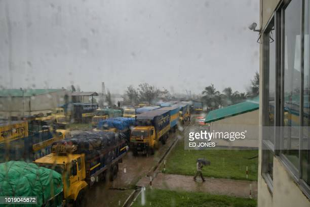 In this photo taken on August 13 trucks line up to transport ginger rice wood and dried fish arriving from Myanmar at the Teknaf port near Cox's...