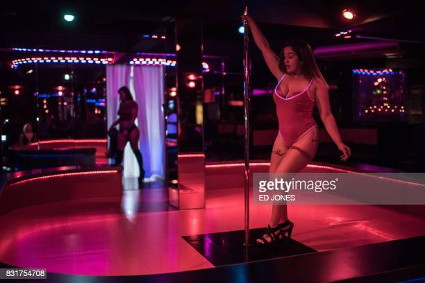 In this photo taken on August 14 a stripper performs at Foxy's strip club in the Tamining area of Guam. - Workers at the club said that they had not...
