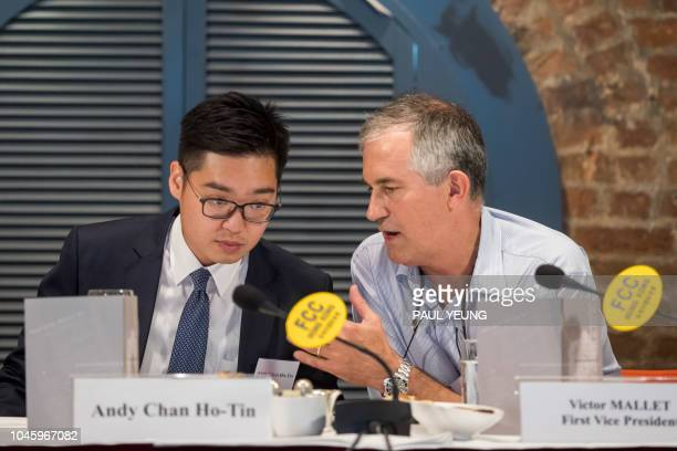 In this photo taken on August 14 Victor Mallet a Financial Times journalist and vice president of the Foreign Correspondents' Club speaks with Andy...