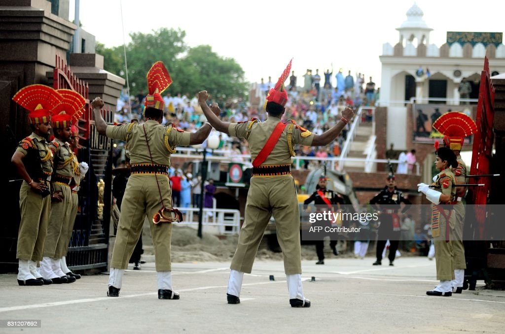 In this photo taken on August 2 Indian and Pakistani border guards square off during the nightly ceremony at the IndiaPakistan border in Wagah From...