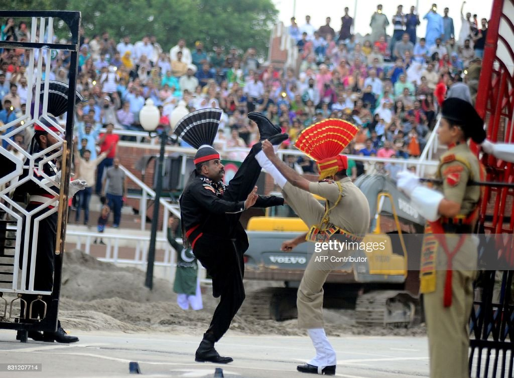 In this photo taken on August 2 Indian and Pakistani border guards take part in the nightly ceremony at the IndiaPakistan border in Wagah From barbed.