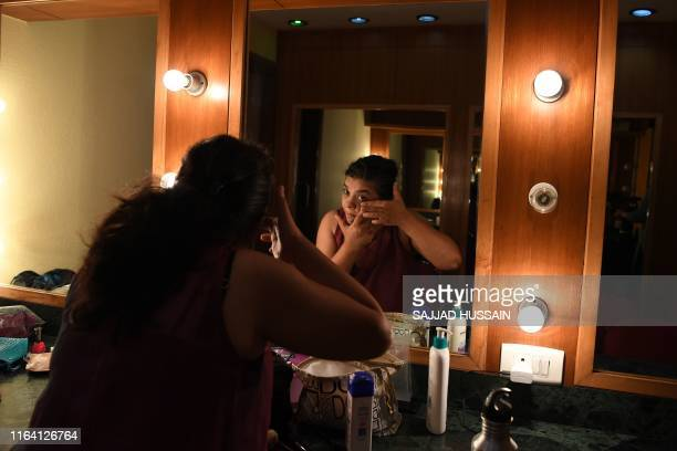 """In this photo taken on August 24 a performer prepares before a production of the show """"Head 2 Head"""" in a theatre at the Indian Habitat Centre in New..."""