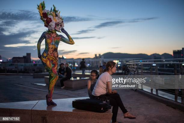 TOPSHOT In this photo taken on August 26 a model poses for a photo during the Daegu International Bodypainting Festival in Daegu The bodies of dozens...