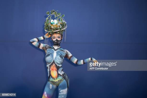 In this photo taken on August 26 a model representing Aya Miyura of Japan poses during the Daegu International Bodypainting Festival in Daegu The...