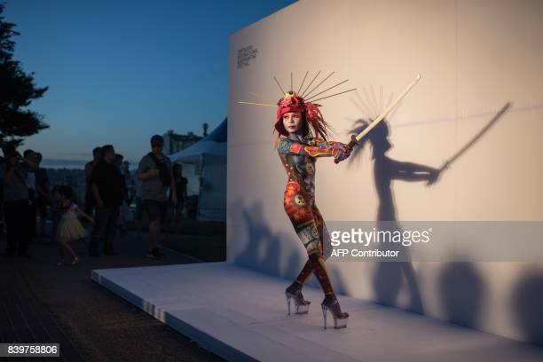In this photo taken on August 26 a model showcases a design by Iwasaki Masakazu of Japan during the Daegu International Bodypainting Festival in...