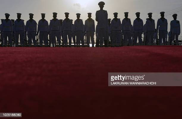 TOPSHOT In this photo taken on August 29 2018 shows Sri Lankan navy personnel stand guard during a ceremony commissioning two naval patrol boats...