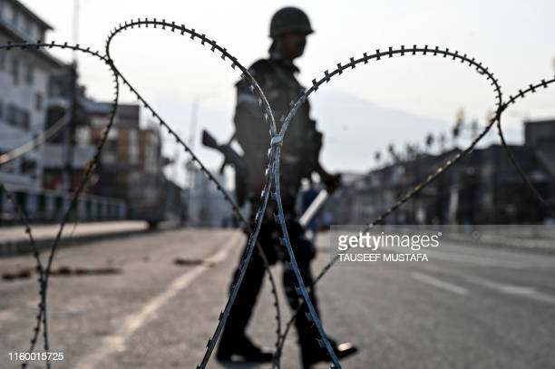 In this photo taken on August 5 an Indian paramilitary trooper stands guard on a road during a curfew in Srinagar India's home affairs minister on...