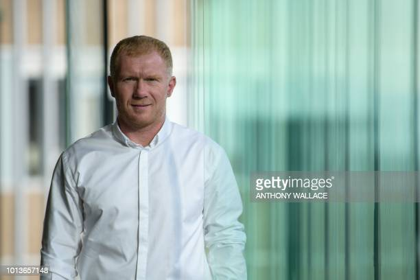 In this photo taken on August 8 former England and Manchester United football player Paul Scholes poses during an interview with AFP in Hong Kong...