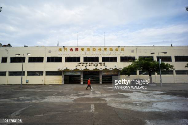 In this photo taken on August 9 Albano Martins president of Macau animal protection NGO Anima walks in front of the recently shut down Canidrome Club...