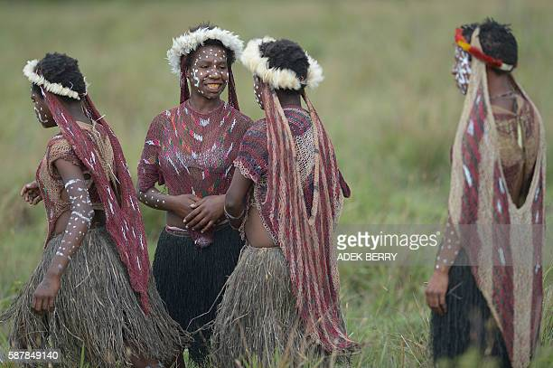 In this photo taken on August 9 Dani tribespeople participate in the 27th annual Baliem Valley Festival in Walesi district in Wamena, Papua Province....