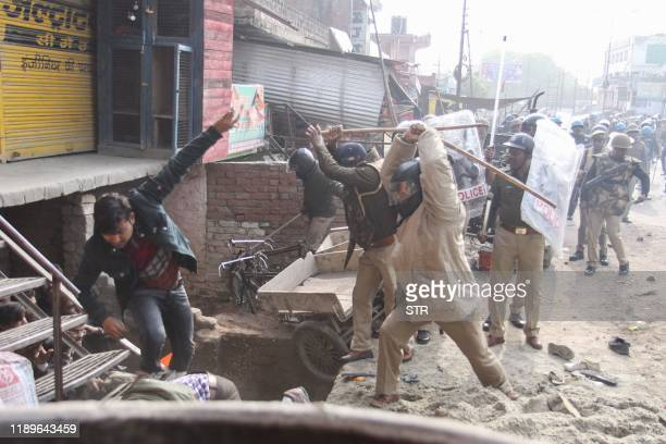 TOPSHOT In this photo taken on December 19 2019 police beat protesters with sticks during a demonstration against India's new citizenship law in...