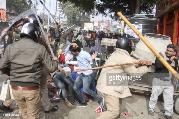 In this photo taken on December 19, 2019 police beat protesters with sticks during a demonstration against India's new citizenship law in Lucknow. -...