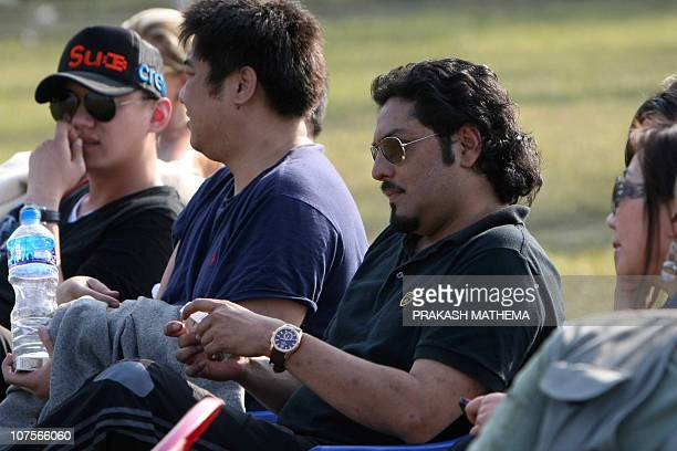 In this photo taken on December 2 Nepalese former crown prince Paras Shah looks on while attending an elephant polo match at Meghauly in Chitwan...