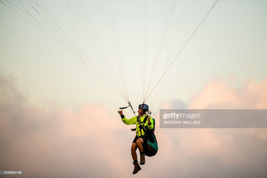 In this photo taken on December 21 a paraglider prepares to take off
