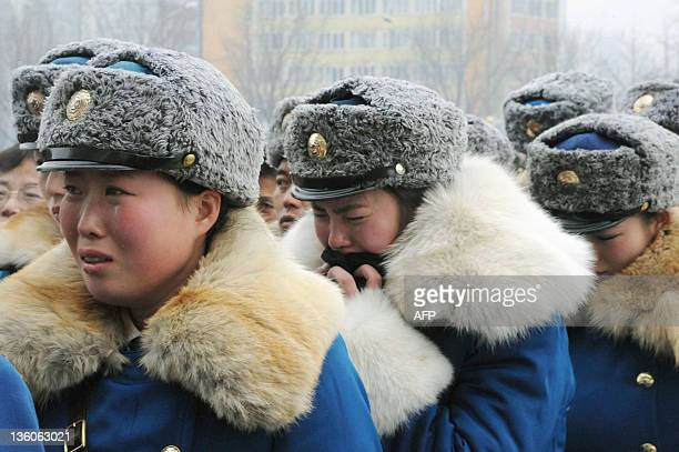 In this photo taken on December 21 North Korean police officers react as they mourn the death of their leader Kim JongIl in Pyongyang Millions of...
