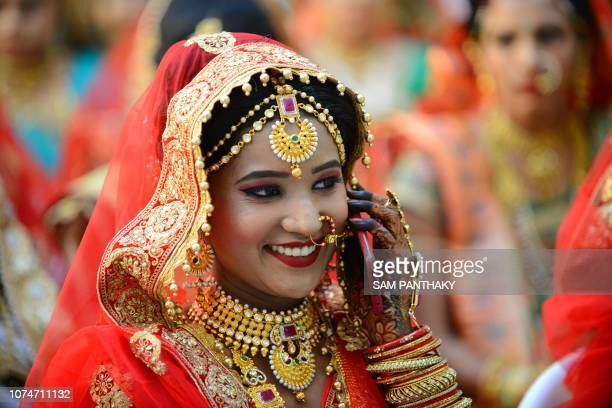 In this photo taken on December 23 2018 an Indian Hindu bride speaks on her mobile phone before her participation in a mass wedding in Surat some...