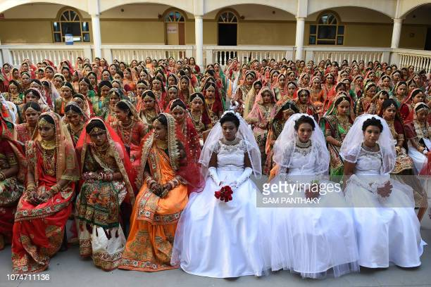 TOPSHOT In this photo taken on December 23 2018 Indian brides pose before a mass wedding in Surat some 270km from Ahmedabad 261 women without fathers...